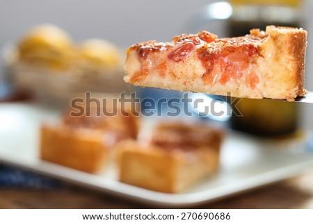 Lemon tarte with grapefruit - stock photo