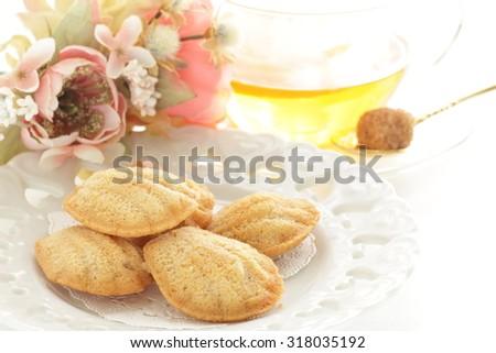Lemon tea and Madeleine cake for afternoon tea image - stock photo
