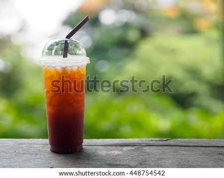 Lemon tea in cup on wooden table with copy space - stock photo