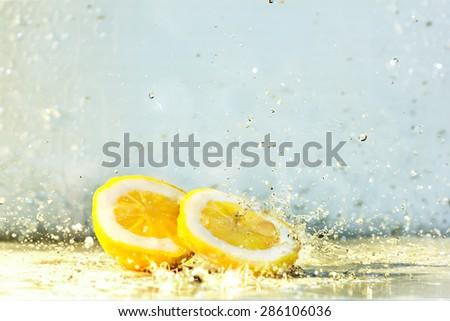 Lemon water drops fresh citrus yellow freshness - stock photo