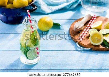 Lemon water in glass on blue wooden table