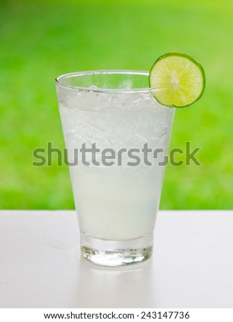 Lemonad in glass on white table close-up - stock photo