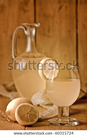 Lemonade drink in glass in rustic setting with sepia tone