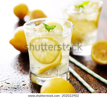 lemonade in a glass with mint garnish - stock photo