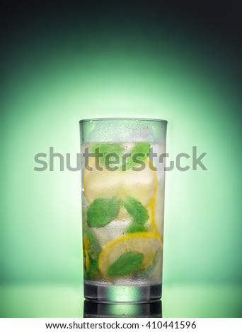 Lemonade on a green background - stock photo