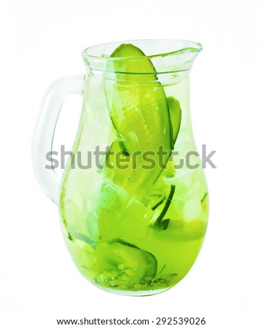 Lemonade Pitcher. Cucumber Lemonade Drink with Ice and Herbs - stock photo