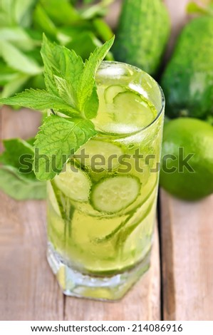 Lemonade with fresh cucumber, lime and mint in glass, close up view - stock photo