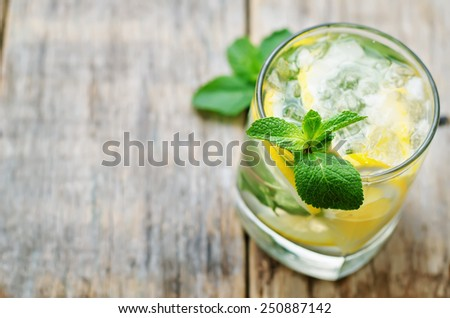 lemonade with mint on a dark wood background. tinting. selective focus - stock photo