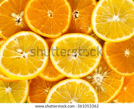 lemons and oranges background - stock photo