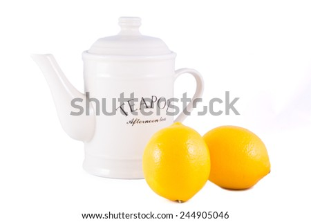 Lemons and Teapot On The Background