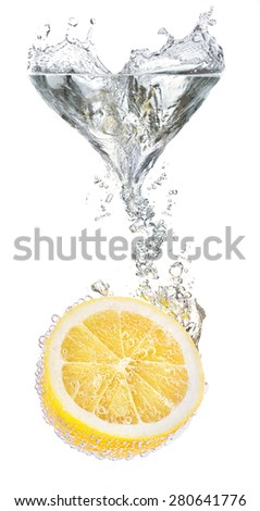 Lemons and water splash. Healthy and tasty food - stock photo
