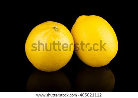 Lemons group isolated on black background - stock photo