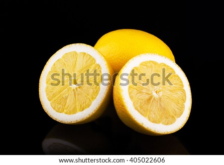 Lemons group isolated on black background   - stock photo