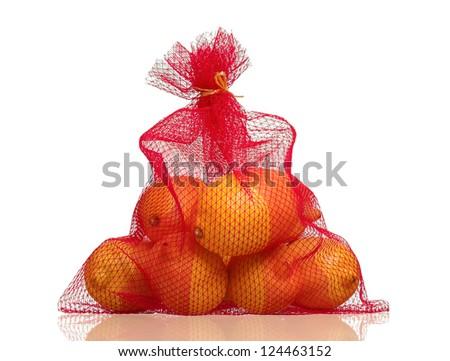 Lemons in net bag isolated on white background - stock photo