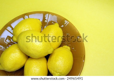 Lemons on a decorative serving plate