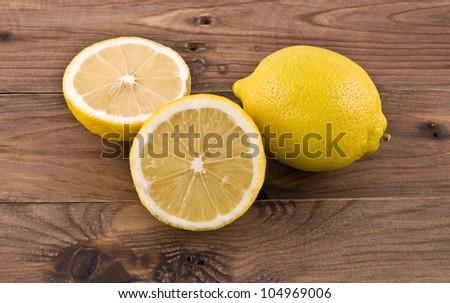 lemons on the wooden table - stock photo