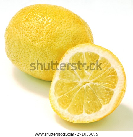 lemons with shadows isolated,the one lemon cut and half and the other whole - stock photo