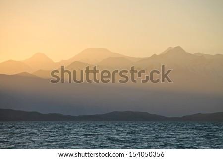 Lenin Peak Pik Lenin behind Karakul Lake, Pamirs, Tajikistan at sunset - stock photo