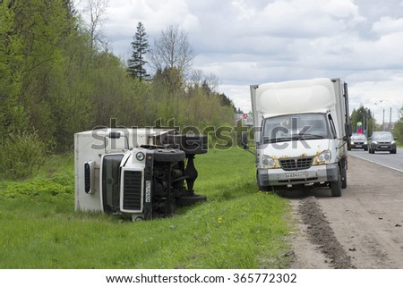 LENINGRAD REGION, RUSSIA - MAY 17, 2015: An overturned truck lies on the side of the highway