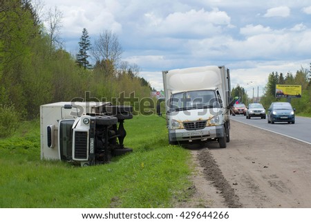 LENINGRAD REGION, RUSSIA - MAY 17, 2015: Overturned camper GAZ-3309 is lying on its side