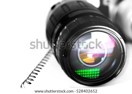 Lens for camera and paper notebook in white background