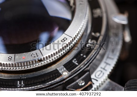 Lens of old retro camera macro closeup - stock photo