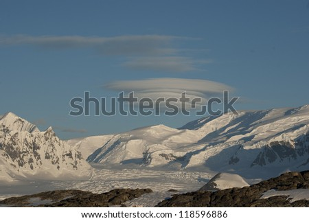 Lenticular obloka over Antarctica on a sunny winter day. - stock photo