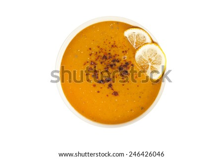 Lentil cream soup with lemon slices with white background - stock photo