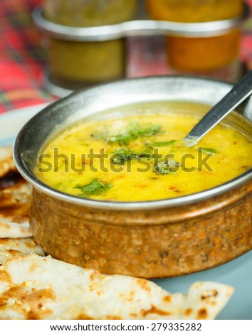 Lentil soup and naan. Indian Cuisine - stock photo