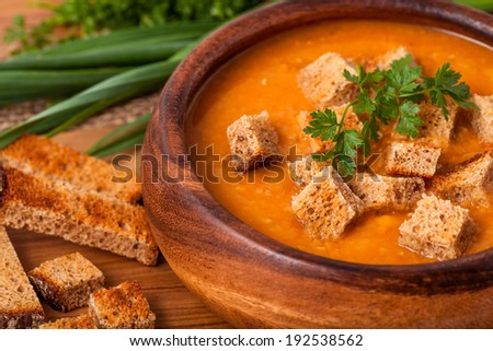 Lentil soup in a wooden dish - stock photo