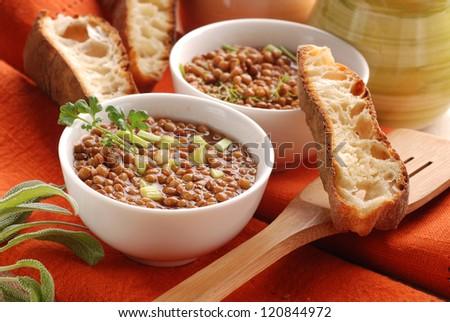 lentil soup in white bowl - stock photo