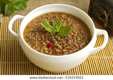Lentil soup on the yellow place-mat - stock photo