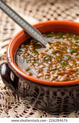 lentil soup with spoon - stock photo
