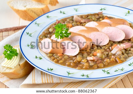 Lentil stew with sausages - stock photo