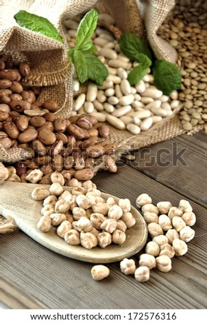 lentils, chickpeas, red beans in cloth bags - stock photo