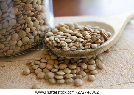 Lentils legumes beans with wooden spoon - stock photo
