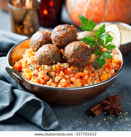 Lentils with vegetables, pumpkin and lamb meatballs, selective focus - stock photo