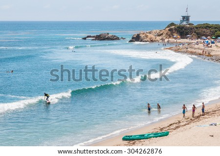LEO CARRILLO STATE PARK, MALIBU, CALIFORNIA - JULY 22, 2015 - Surfers, swimmers and sunbathers enjoying a summer day in southern California. - stock photo