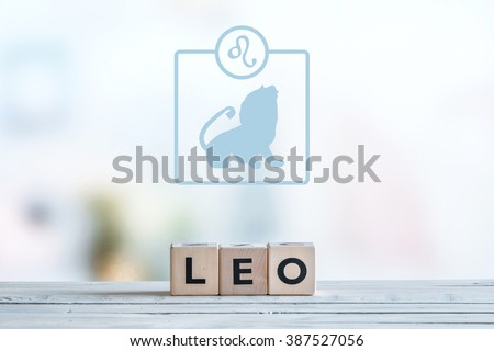 Leo star sign on a wooden table - stock photo