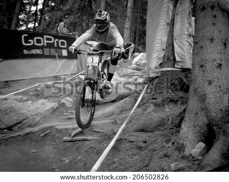 LEOGANG, AUSTRIA - JUNE 15, 2014: Aaron Gwin of Specialized Racing DH is seen during a training run before the final of the UCI Downhill Mountain Bike World Cup in Leogang, Austria.