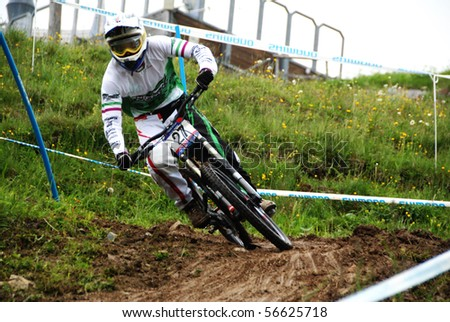 LEOGANG, AUSTRIA - JUNE 20: Participant in the UCI Mountain Bike World Cup Downhill & Four Cross June 18-20, 2010 in Leogang, Austria. - stock photo
