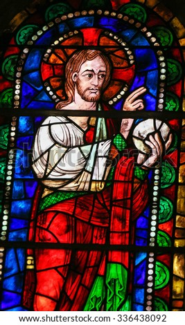LEON, SPAIN - JULY 17, 2014: Stained glass window depicting Jesus Christ blessing the Bread in the Basilica of San Isidoro in Leon, Castille and Leon, Spain. - stock photo