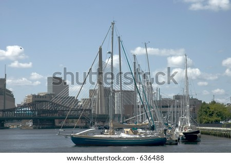 Leonard P. Zakim Bunker Hill Bridge  and sailing boats masts taken from St Charles River., Boston, Massachusetts - stock photo