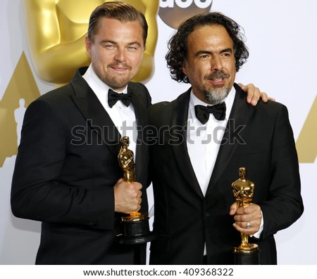 Leonardo DiCaprio and Alejandro G. Inarritu at the 88th Annual Academy Awards - Press Room held at the Loews Hotel in Hollywood, USA on February 28, 2016. - stock photo