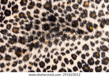 Leopard fur texture background. - stock photo
