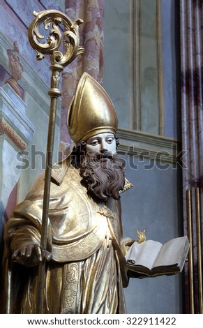 LEPOGLAVA, CROATIA - SEPTEMBER 21: Saint Ambrose on the main altar of Holy Cross, parish Church of the Immaculate Conception of the Virgin Mary in Lepoglava, Croatia on September 21, 2014 - stock photo