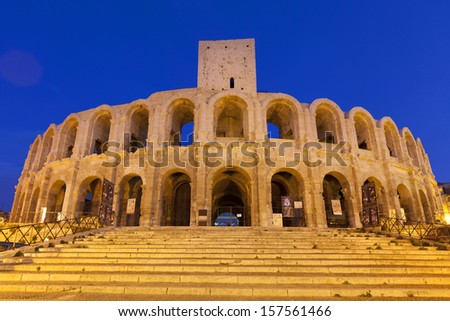 Les Ar�¨nes d'Arles is an old Roman amphitheatre situated in Arles, Provence-Alpes-Cote-d'Azur, France, Europe. Illuminated at night. - stock photo