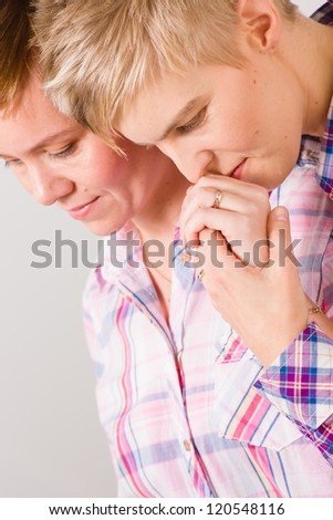 Lesbian kissing her girlfriend's hand, shared a moment, vertical close-up format - stock photo