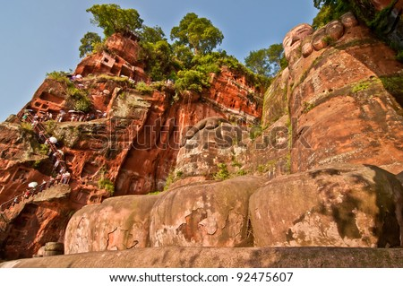 Leshan Buddha view with people on stairs - stock photo
