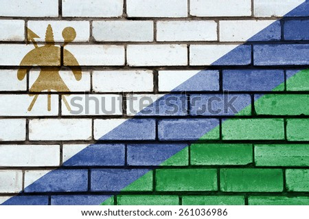Lesotho flag painted on old brick wall texture background - stock photo
